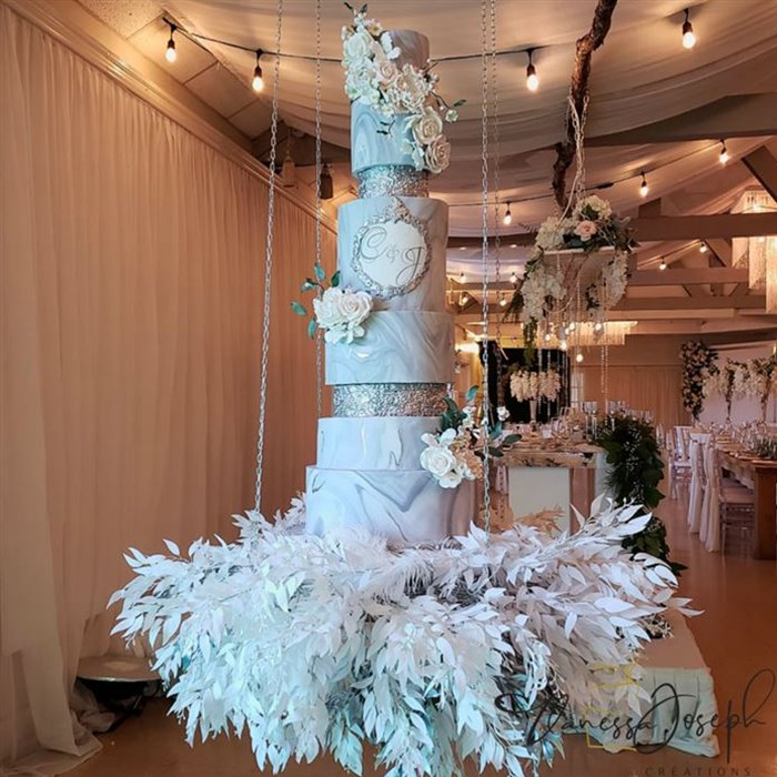 rustic chic wedding cake marbled gray white silver on hanging table with white and silver leaves