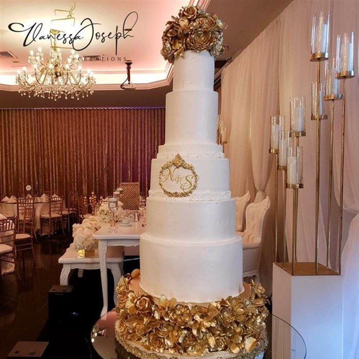 white wedding cake with golden flowers tiers