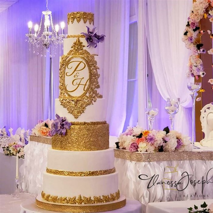 Royal white and gold wedding cake with purple lilas flowers