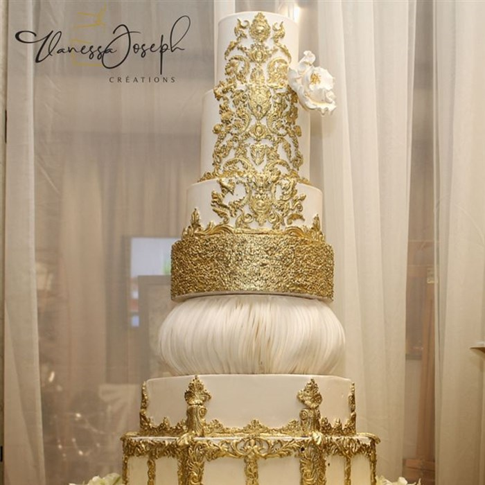Royal white and gold wedding cake