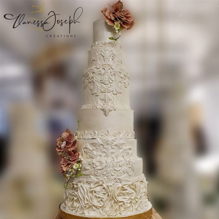 Baroque white wedding cake with pink flowers