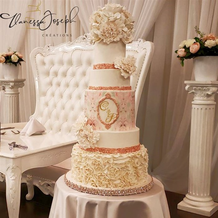 romantic white and rose gold wedding cake with white flowers