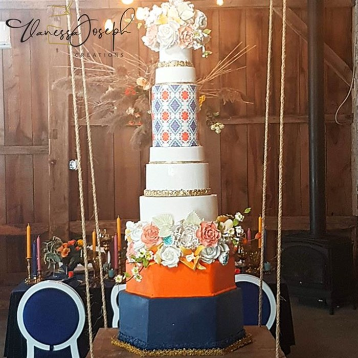 Spanish style orange white navy blue and gold wedding cake