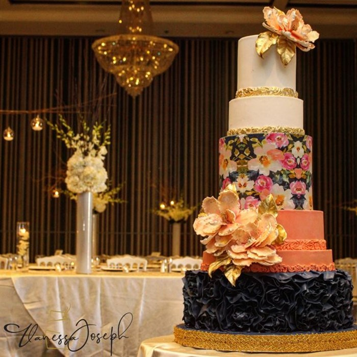 Modern white, salmon, navy blue wedding cake with flower pattern
