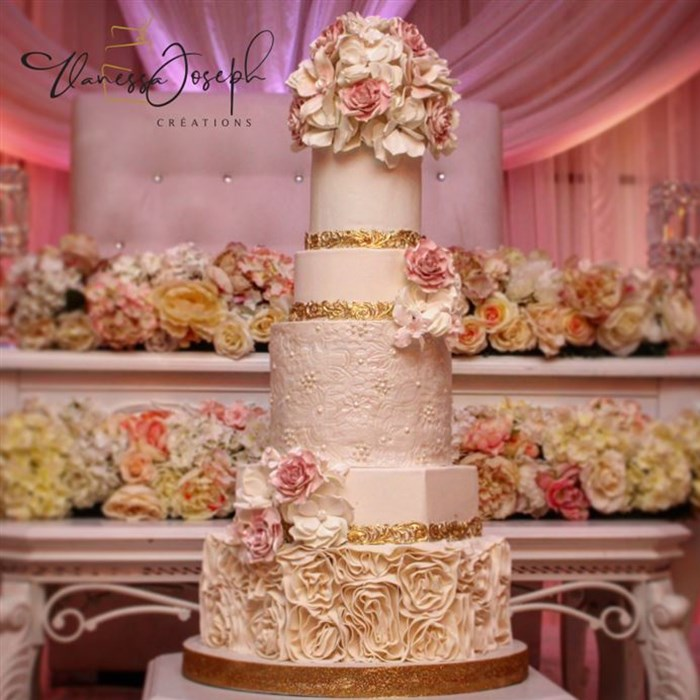 romantic white and gold wedding cake with pink flowers