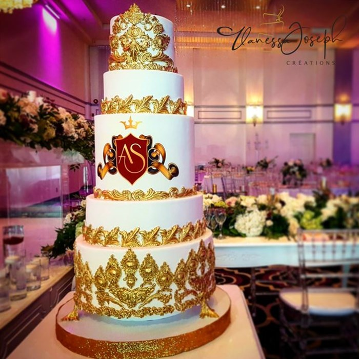 Monogrammed king and queen crown style, white and gold wedding cake