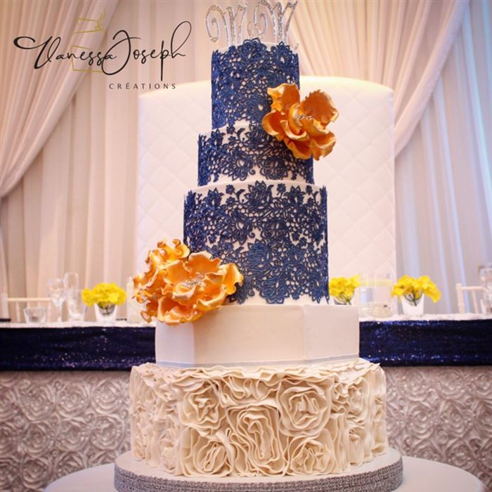 white wedding cake with blue lace marine and yellow flowers
