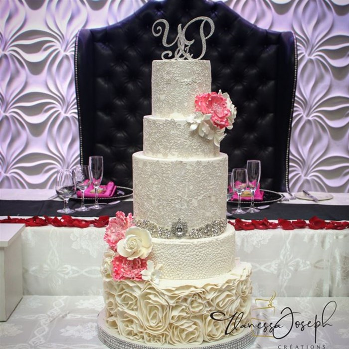 white wedding cake with lace and fuchsia flowers