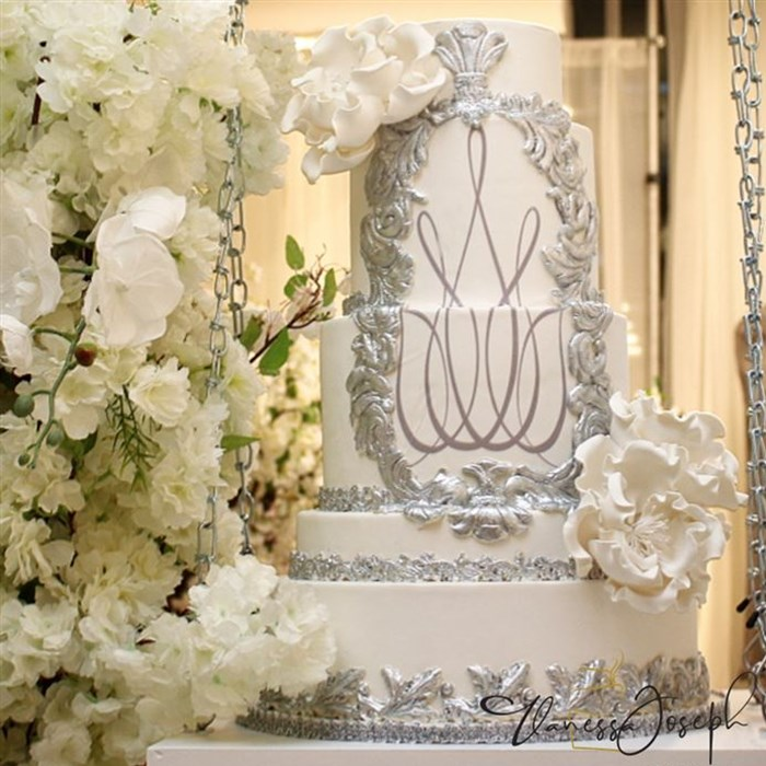 Baroque white and silver wedding cake with white flowers