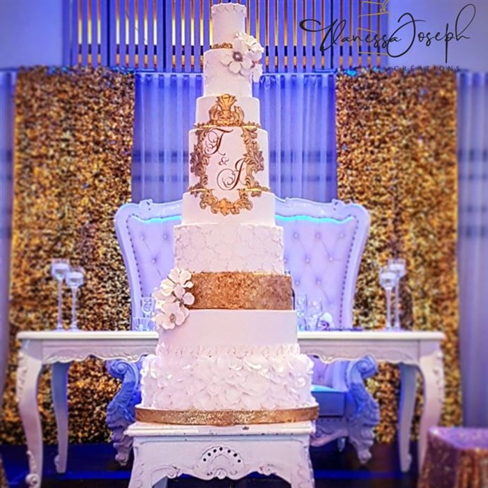 Spectacular baroque white and gold wedding cake