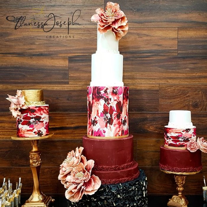 Trio of white, burgundy, black and gold wedding cake