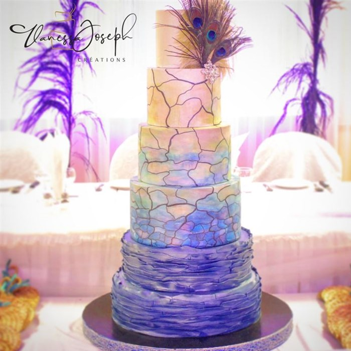 Peacock and stained glass style white, marine blue, turquoise, green and yellow wedding cake